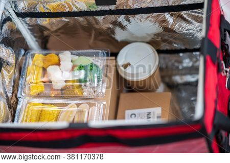 Food Is Packed In A Box To Be Delivered To Customers