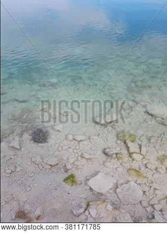 Azure Clear Sea Water. Background Of Transparent Blue Sea Water Top View. Crystal Clear Water, Throu