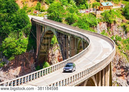 Car On The Djurdjevic Tara Bridge Over The Tara River Near Zabljak In Montenegro
