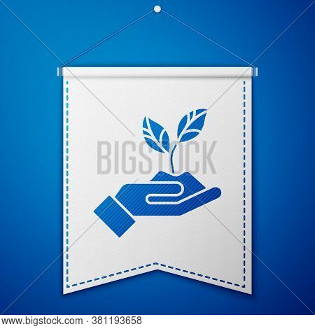 Blue Plant In Hand Of Environmental Protection Icon Isolated On Blue Background. Seed And Seedling.