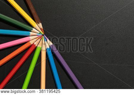 Colorful Background By Colored Pencils Stacked On The Table.wood Colored Pencils For Stationary Supp