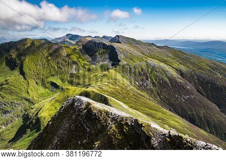 Beautiful Scottish Highlands Landscape. View Of The Mamores Ridge In Scottish Highlands On A Sunny S