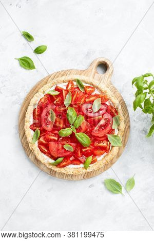 Summer Tomato Tart With Soft Cheese And Basil, Top Down View