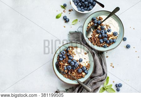 Granola And Blueberry Breakfast With Plain Yogurt, Top Down View, Space For A Text