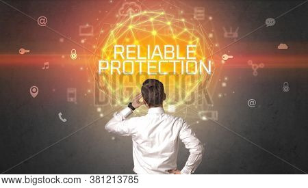 Rear view of a businessman with RELIABLE PROTECTION inscription, online security concept