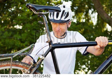 Man repairing a bike during a bike tour