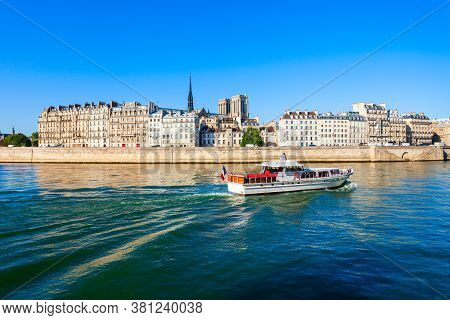 Tourist City Tour Boat On The Seine River In Paris In France