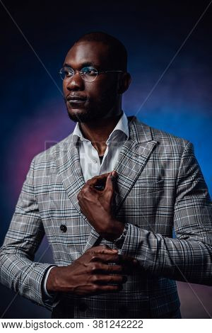 Business Expensive Stylish Costume And African Person Dressed In It. A Serious Looking Man Dressed I