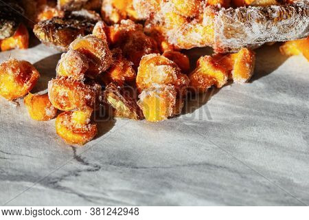 Frozen Mushrooms On A Gray Background. Storage Of Frozen Food. Frozen Product. Chanterelles And Porc