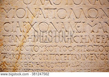 Fragment of the ancient greek letters carved on the stone