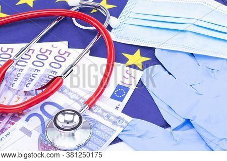The Photo Shows A Mouth And Nose Protector With Disposable Gloves, Cash And A Stethoscope On A Europ