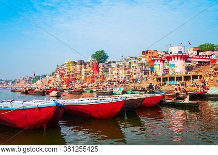 Varanasi, India - April 12, 2012: Colorful Boats And Ganges River Bank In Varanasi City In India