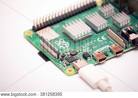 Kiev, Ukraine - August 13th, 2020: Usb Type 3 Cord With A Micro Sd Card Lying Next To A Single-board