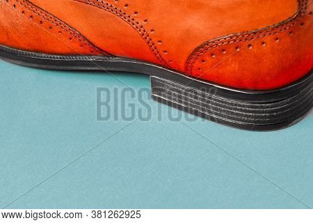 The Heel Of Mens Shoes On A Colored Background Close-up. Mens Shoes. Shoe Sales. Stylish Accessory M