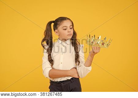 Making Her Prom Look Super Special. A Future Prom Queen. Cute Small Child Holding Golden Crown For S