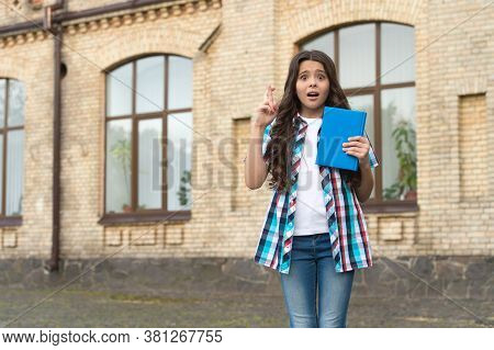 Not Jinxing It. Little Child Keep Fingers Crossed Outdoors. Small Girl Worry About Examination Resul