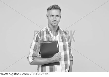 Man With Folder Yellow Background. Businessman Hold Book For Notes. Guy Has Notepad For Writing. Han