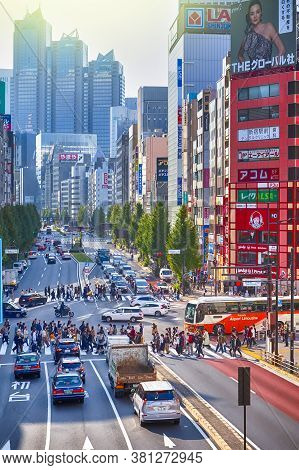 Tokyo, Japan - 9 November, 2019: Central Part Of Tokyo City With Traffic Lanes With Pedestrians And