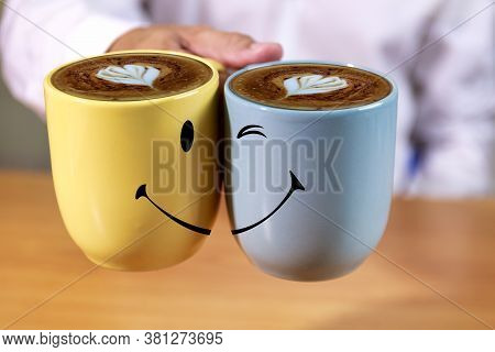 Close Up Hand Businessman Hold Coffee Cups With Smle Face Background. Hand Man Hold Yellow And Blue