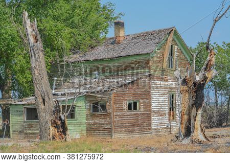 An Old, Abandoned, Rundown Home In The Countryside Of Delta, Colorado