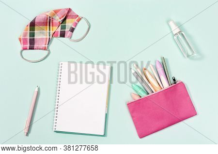 Flat Lay With Notebook And Stationery For Girl, Pink Fabric Mask For Protection From Infections And