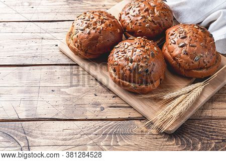Bread Products With Cereals And Seeds On A Wooden Background. Lean Healthy Buns, Carbohydrate Pastri