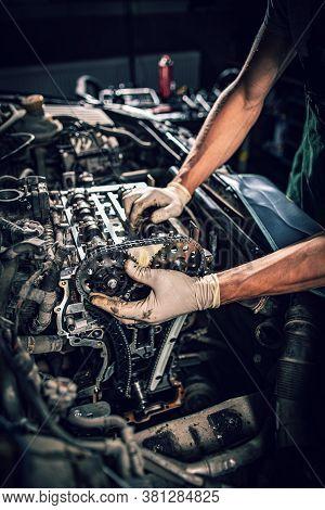 Automobile Mechanic Repairman Hands Repairing A Car. Car Service And Maintenance Concept