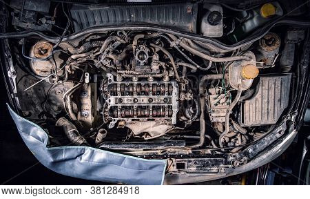 Top View Of Used Engine And Auto Parts. Bad Car Maintenance Concept