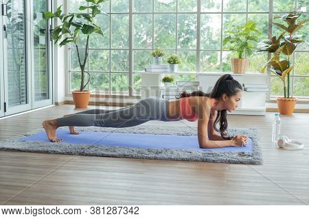 Workout At Home. Young Asian Woman Doing Working Out At Home And Doing Plank.