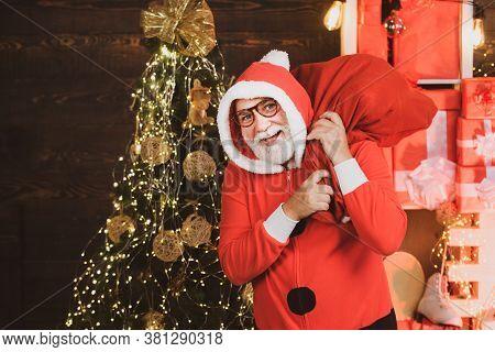 Happy Santa Claus In Santa Hat. Santa Old Man Posing On Vintage Wooden Background. Christmas Greetin