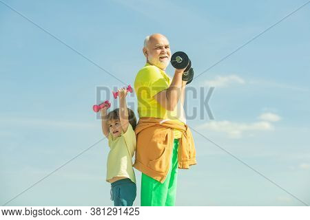 Motivation And Sport Example Concept. Senior Man And Child Exercising On Blue Sky. I Love Sport. Act
