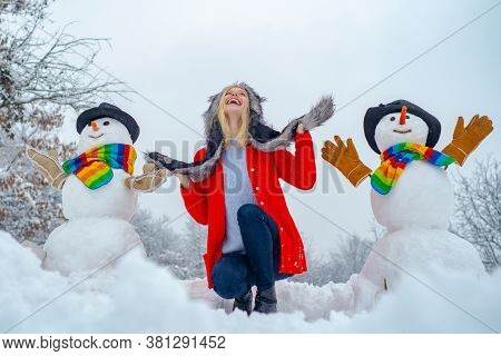 Theme Christmas Holidays Winter New Year. Happy Winter Girl Making Snowman. Christmas Excited People