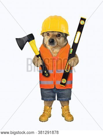 The Beige Dog Worker In Boots, A Vest And A Helmet Is Holding A Construction Ax And A Level. White B