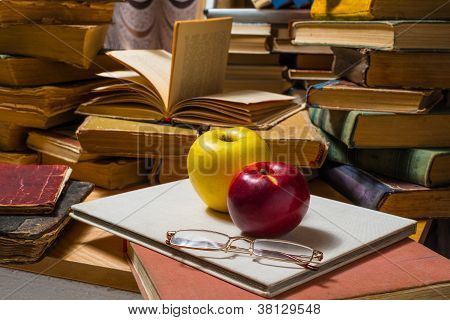 Glasses apples and books