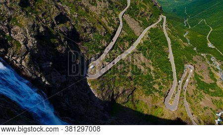 Trolls Path Trollstigen Winding Scenic Mountain Road With Many Cars, Norway Europe. National Tourist