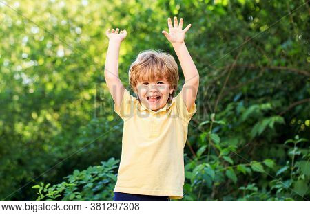 Funny Baby Boy Isolated On A Background Of Green Trees. Smiling Child Boy. Heerful Cheerful Kid. Por