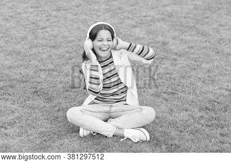 Pleasant Time. Child Headphones Listen Music. Do Not Bother Me. Cool Girl Headphones Listening Music