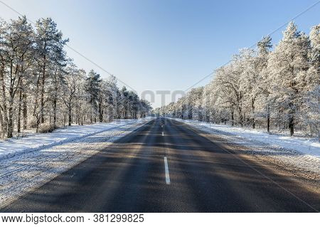 Snow-covered Winter Road For Car Traffic, Frosty Snow Weather And Blue Sky, Sunny Day On The Road, S