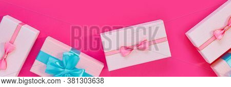 Banner From Set Of Beautiful Gift Boxes With Blue Bows On Pink Background. Holiday Sale. Copy Space