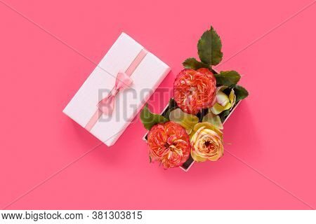 Bouquet Of Beautiful Red Roses In Gift Box On Pink Background. Copy Space For Text, Invitation Or Co