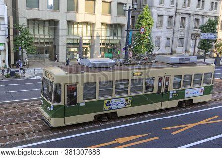 August 5, 2020, Hiroshima, Japan - A Hiroshima Streetcar (hiroden) Run-pass, Through Hondori Street.