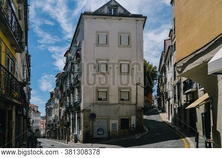 Wide Angle View Of Narrow Old Streets Of Alfama Neighborhood In Lisbon, Portugal