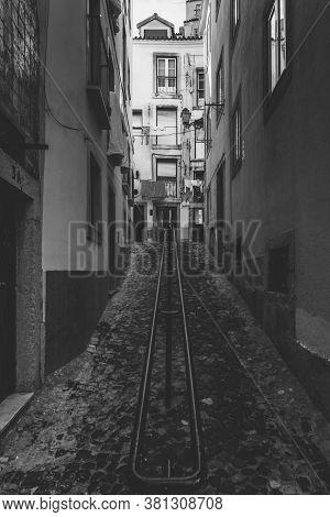 Vertical View Of Narrow Old Alleyways Of Alfama Neighborhood In Lisbon, Portugal