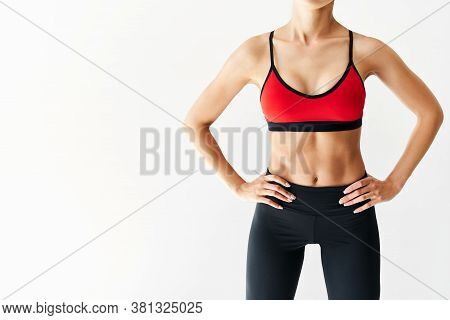 Cropped Image Of Fit Woman Torso On White Background With Copy Space. Female With Perfect Abdomen Mu