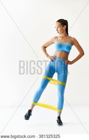 Sporty Woman With Loop Band Esistance Workouts On White Background