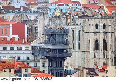 Lisbon City In Portugal. Cityscape With Santa Justa Elevator.