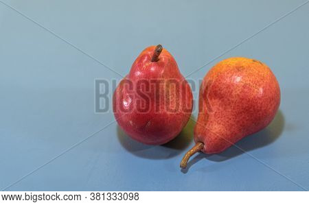 Pear Fruits (pyrus Comunis L.) Variety Red On Blue Background
