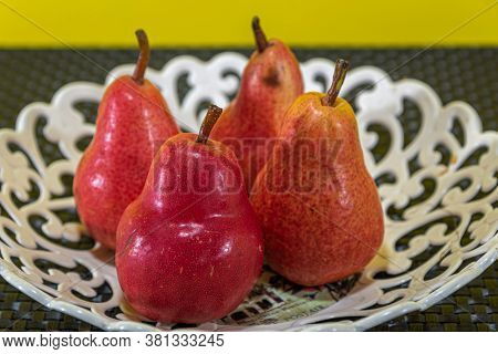 Pear Fruits (pyrus Comunis L.) Variety Red On White Tray.