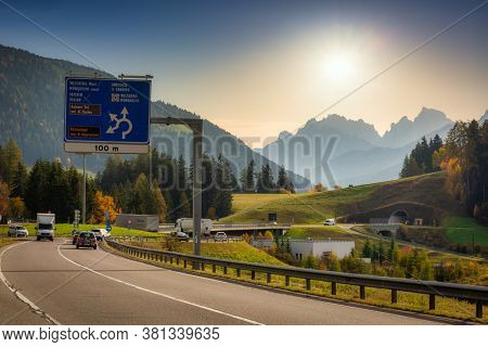 South Tyrol, Italy - October 25, 2019: Road through South Tyrol of Italy with a view of the Dolomite peaks