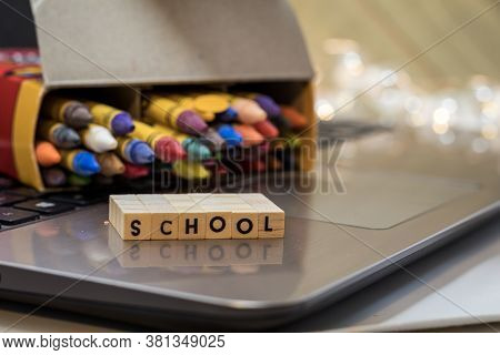 School Virtual Learning Concept With Wood Block Letters On Laptop.  Distance Learning, Remote Learni